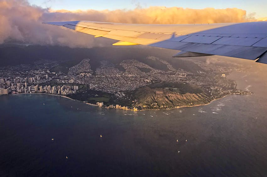 View of Diamond Head crater located on Oahu, Hawaii from airplane after takeoff
