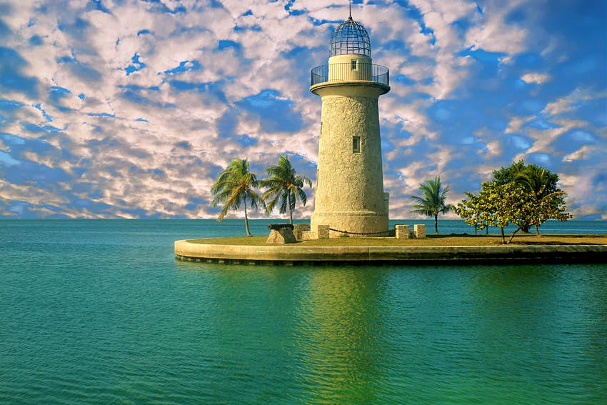 A Lighthouse stands on a narrow spit of land