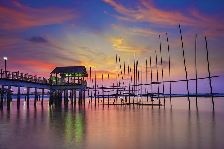 Red, blue and purple sky of sunrise at changi beach