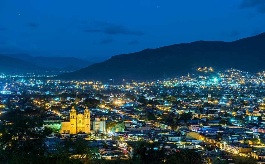 Historic centre of Oaxaca city lit up at night with its landmark Santo Domingo church