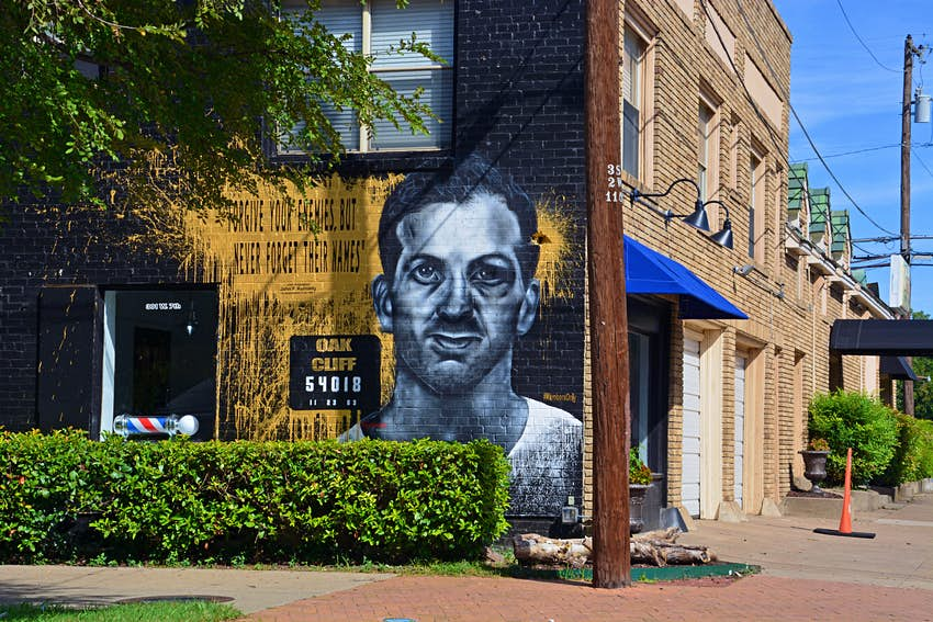 A mural is painted in the Oak Cliff, Bishop Arts District to recall Lee Harvey Oswald and his assassination of John F Kennedy.