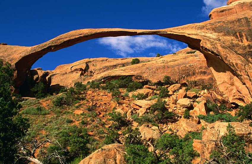 A large stone arch and a blue sky above