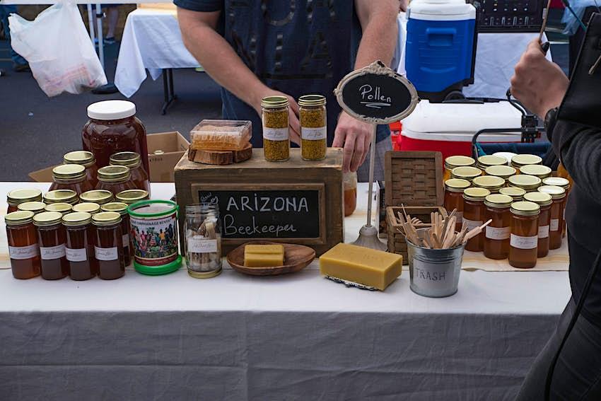 PHOENIX, ARIZONA - NOVEMBER 25 2017 - Arizona Beekeeper raw honey booth at the Phoenix Public Market held every Saturday morning.