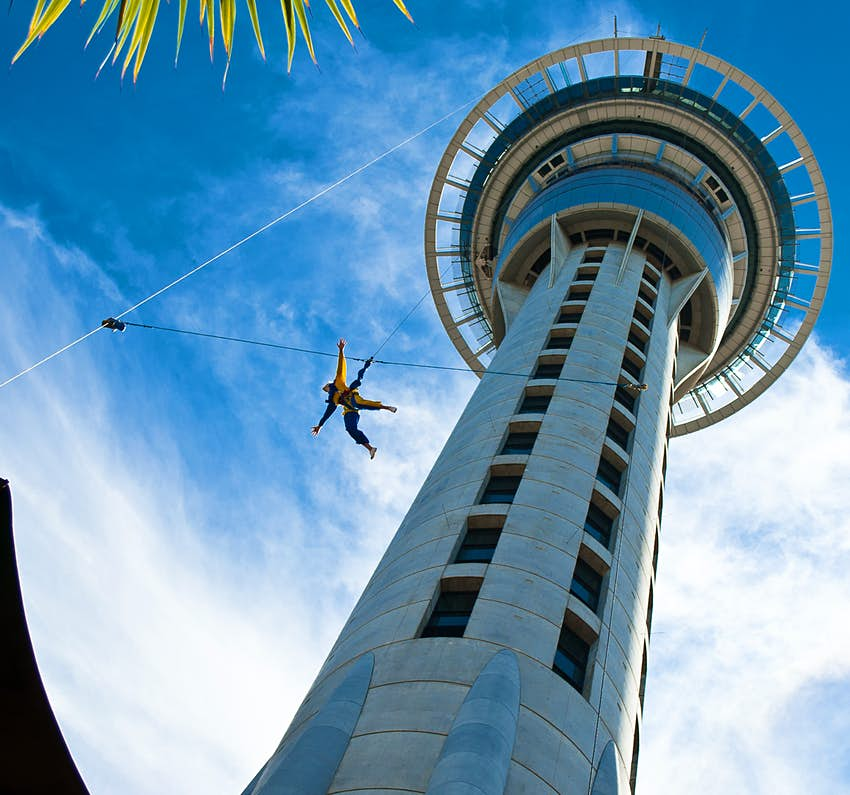 Someone jumps off the Auckland Sky Tower on a bright clear day