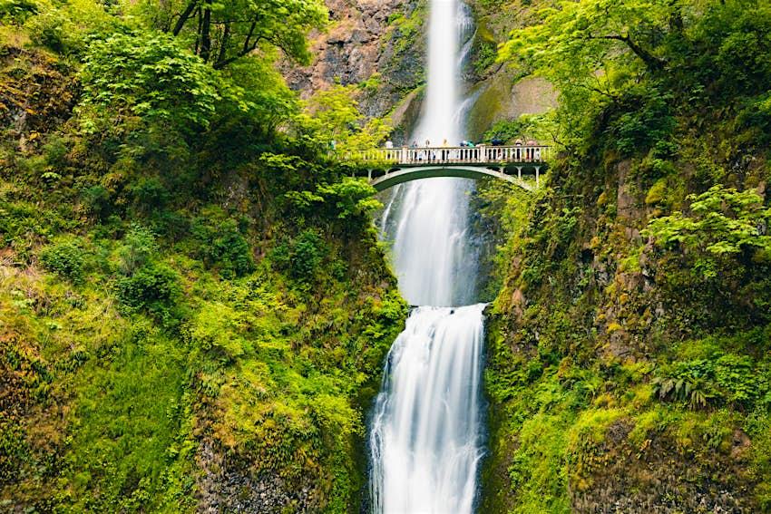 Visitors stand on a bridge at Columbia River Gorge near Portland, Oregon