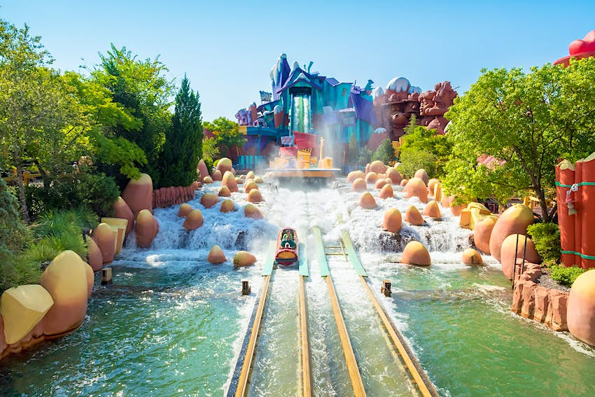 A water ride splashes down on a sunny day