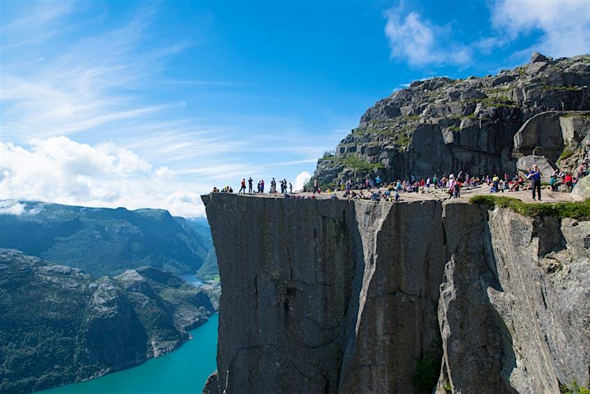 People standing on the Preikestolen (Pulpit Rock) cliff in Norway