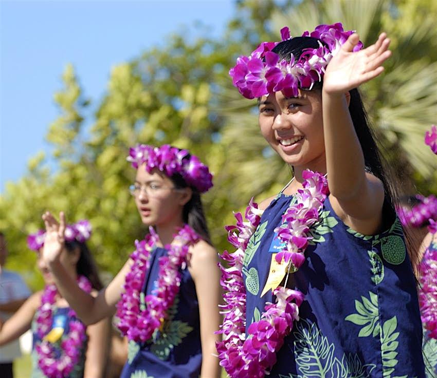 A girl waves during an Aloha Festival