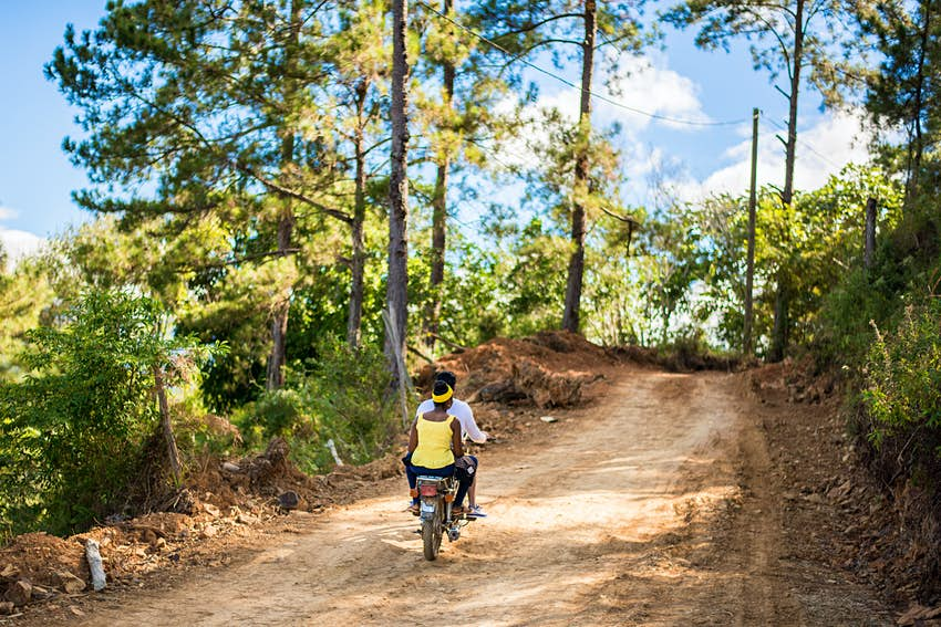 Bike riders cycling through the countryside of Dominican Republic