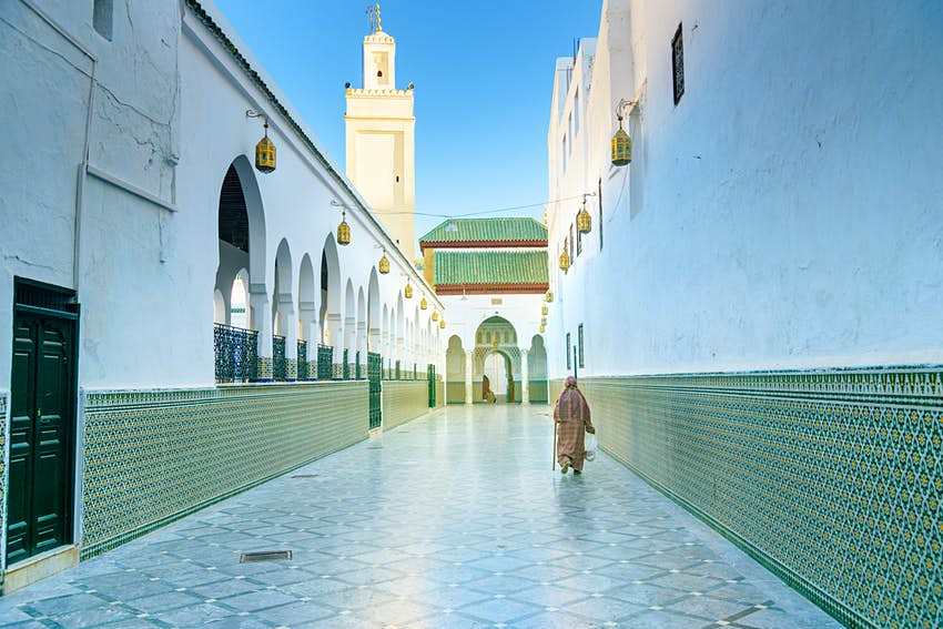 Man walking to the Mosque of Moulay Idriss in Moulay Idriss Zerhoun, Morocco