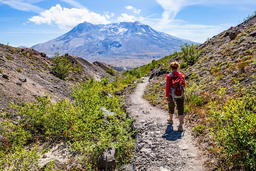 A woman hiking in Mt St Helens National Monument, Washington, USA.