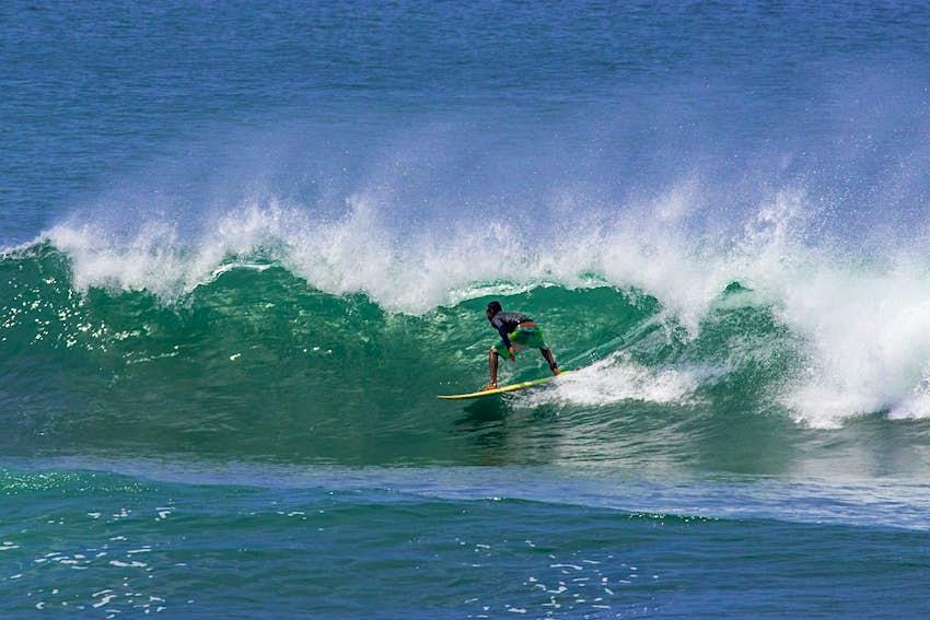A surfer rides a large wave in Santa Catalina, Panama.