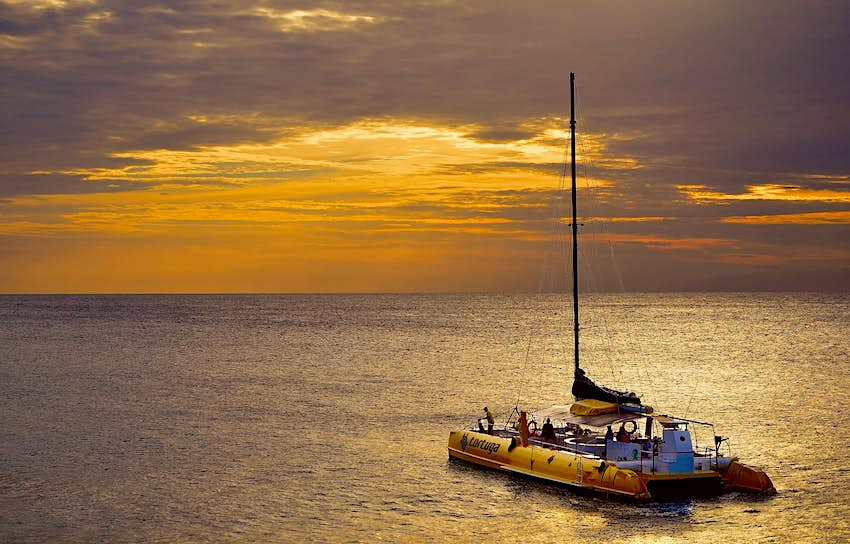A boat heads out to Ricks Cafe in Negril at sunset in Negril
