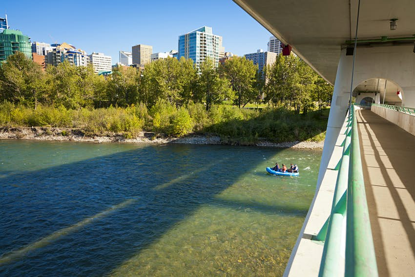 Inflatables floating down a river past downtown Calgary.