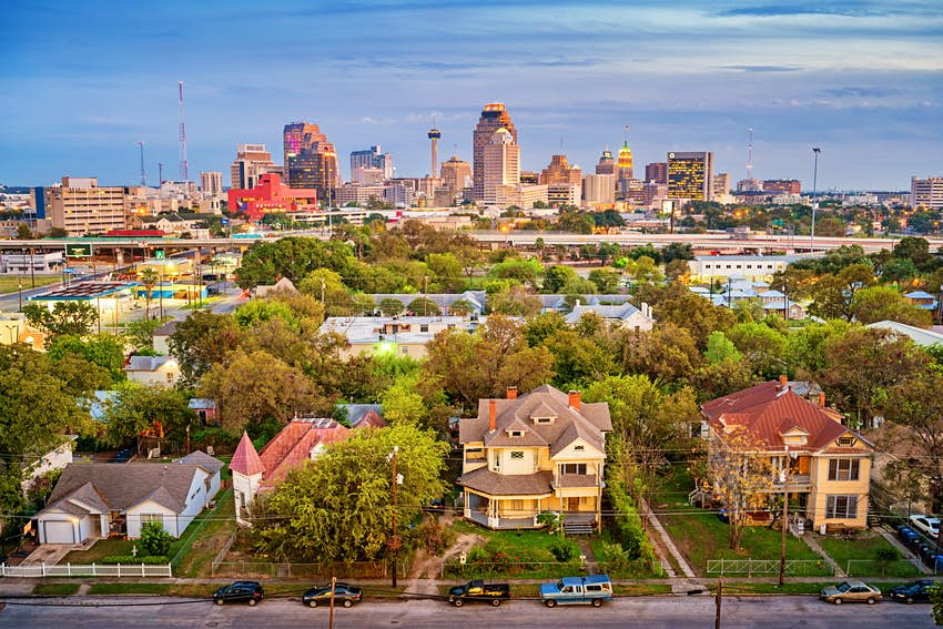 Stock photograph of a residential district and the downtown skyline of San Antonio Texas USA at twilight.