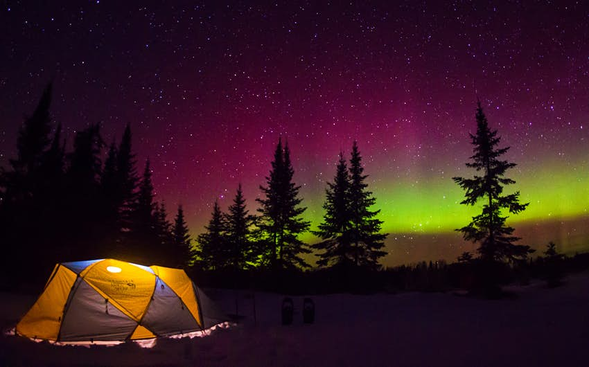 Tent camping under the northern lights in Minnesota