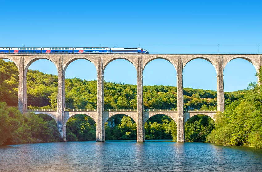 French TGV train on the upper level of a two-tier stone viaduct