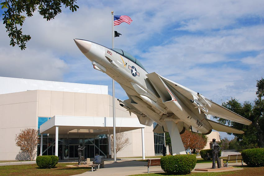 The exterior of the National Naval Aviation Museum with a jet pointing to the sky