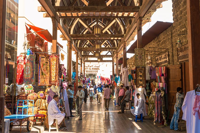 Textile souk crowded with people at daytime, Bur Dubai, Dubai, United Arab Emirates