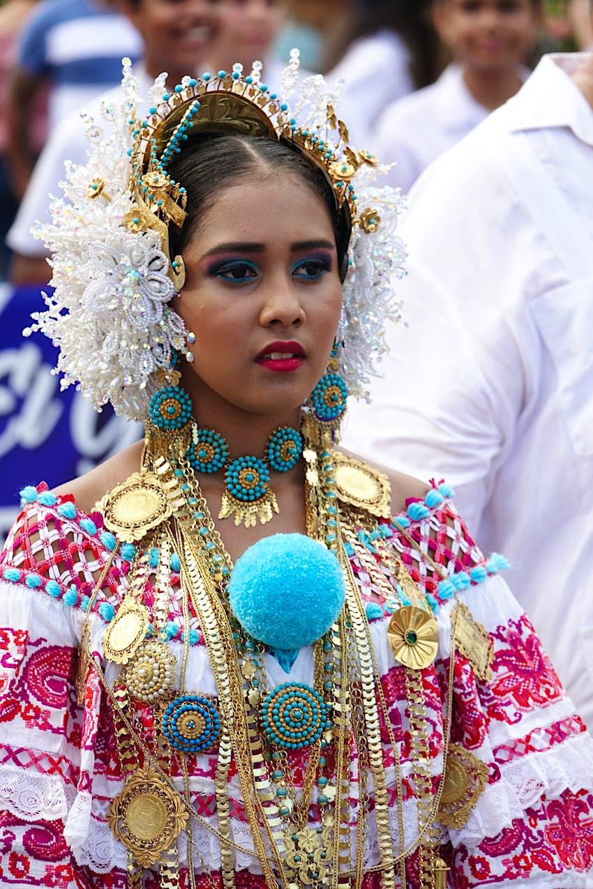A woman in traditional costume on Día de la Independencia