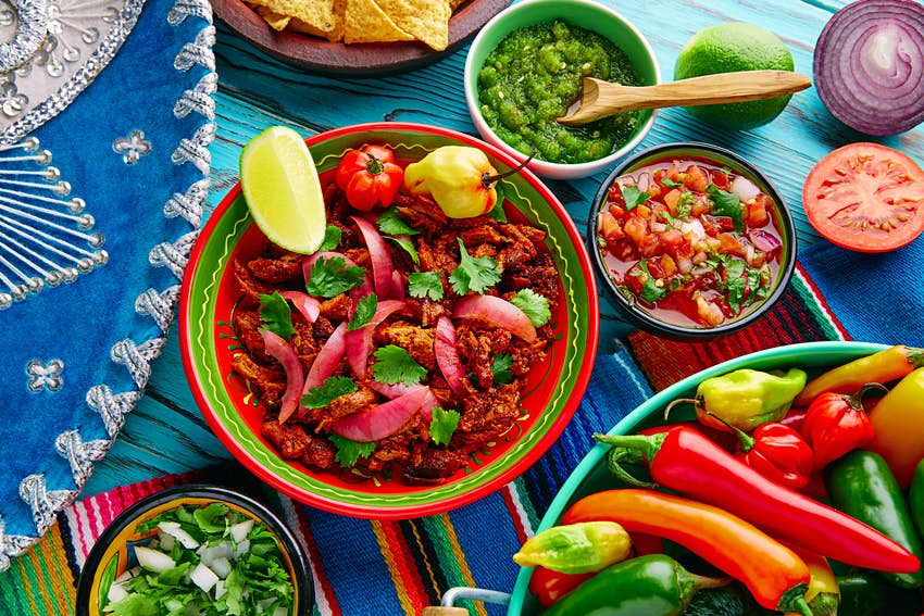 A table covered in a colorful array of Mexican food