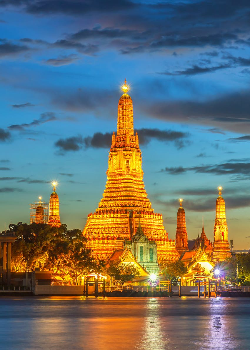 A Wat Arun illuminated Buddhist religious places at dusk, Bangkok, Thailand