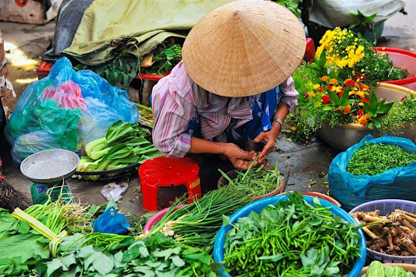 Vietnamese vegetable seller at the market.