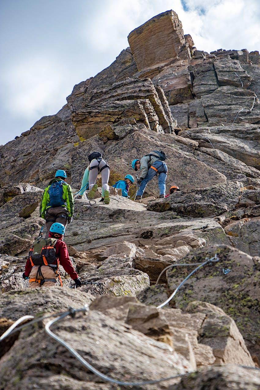 Climbers ascend the via ferrata