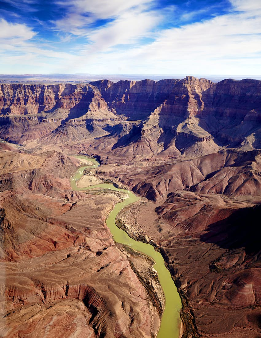 A deep canyon with a river running through the middle