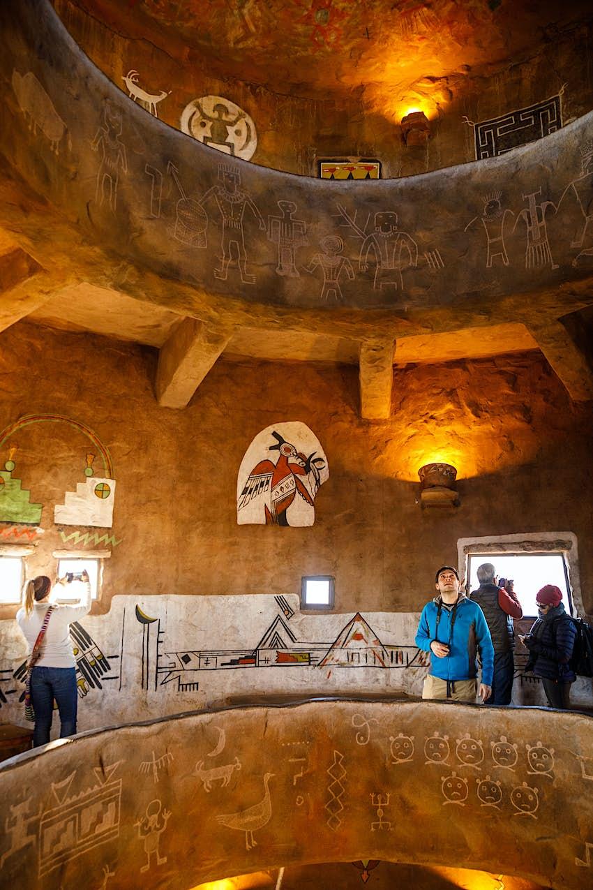 Native American murals decorate a room