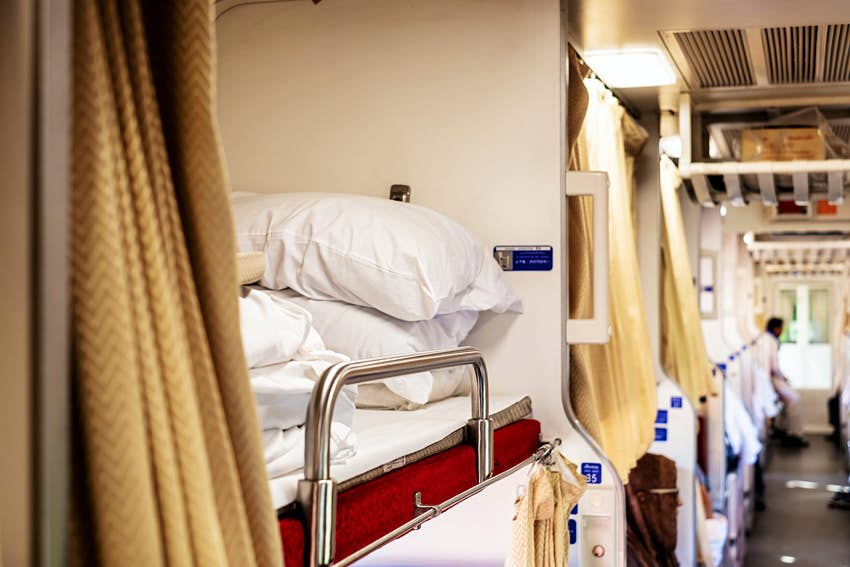 Image of a second class sleeper car on an overnight train in Thailand