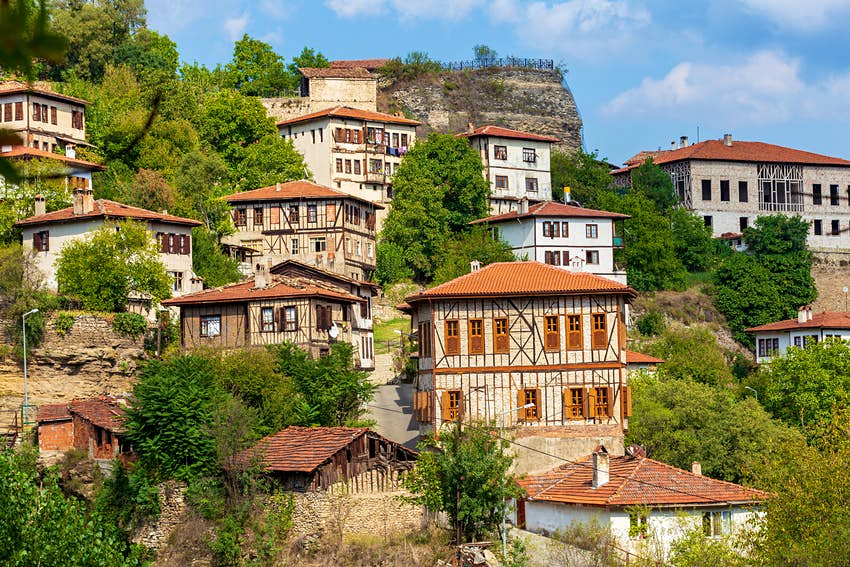 A series of timbered houses built into a hillside