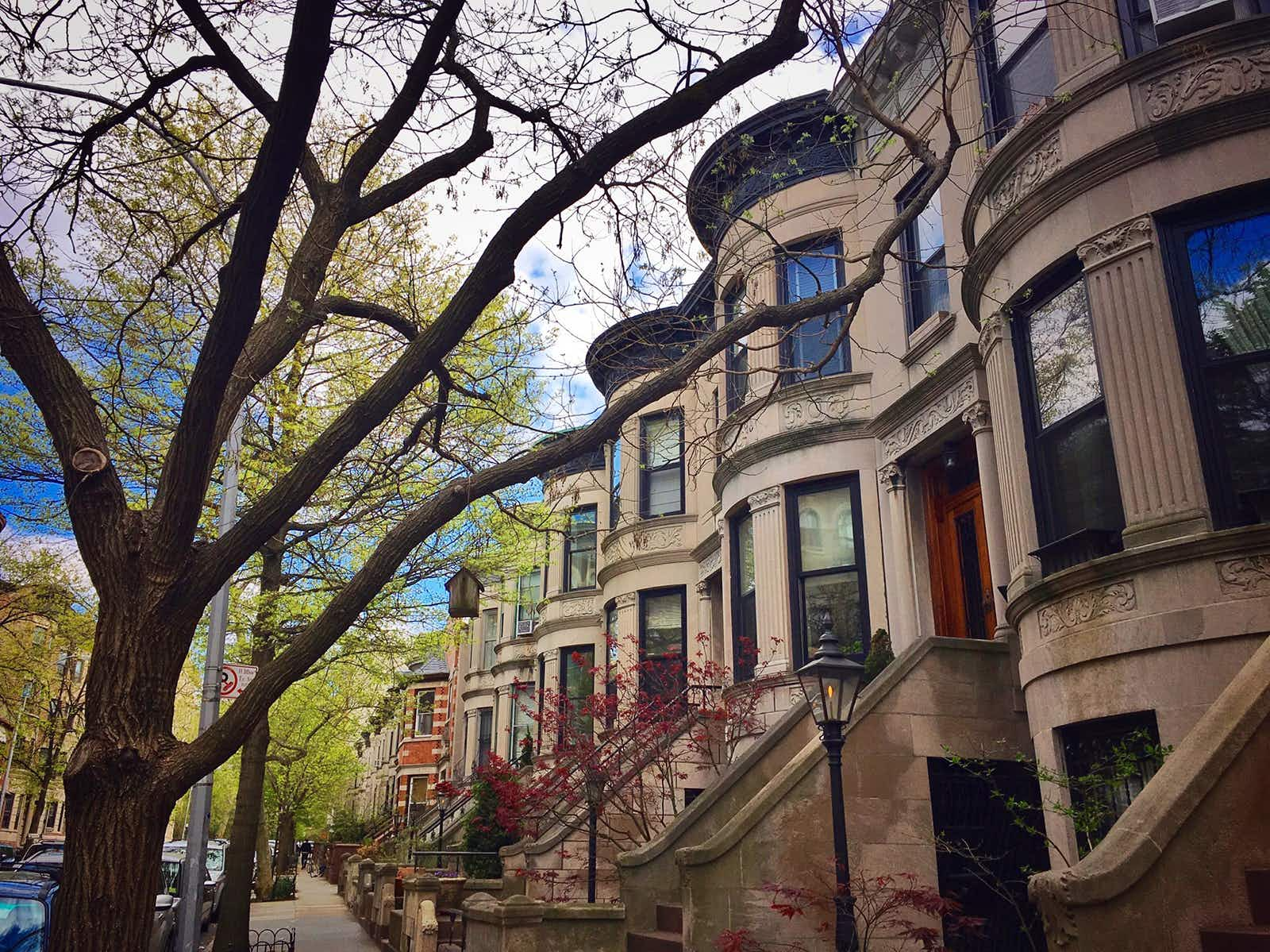 19th-century brownstones in Park Slope, Brooklyn during springtime on a sunny day