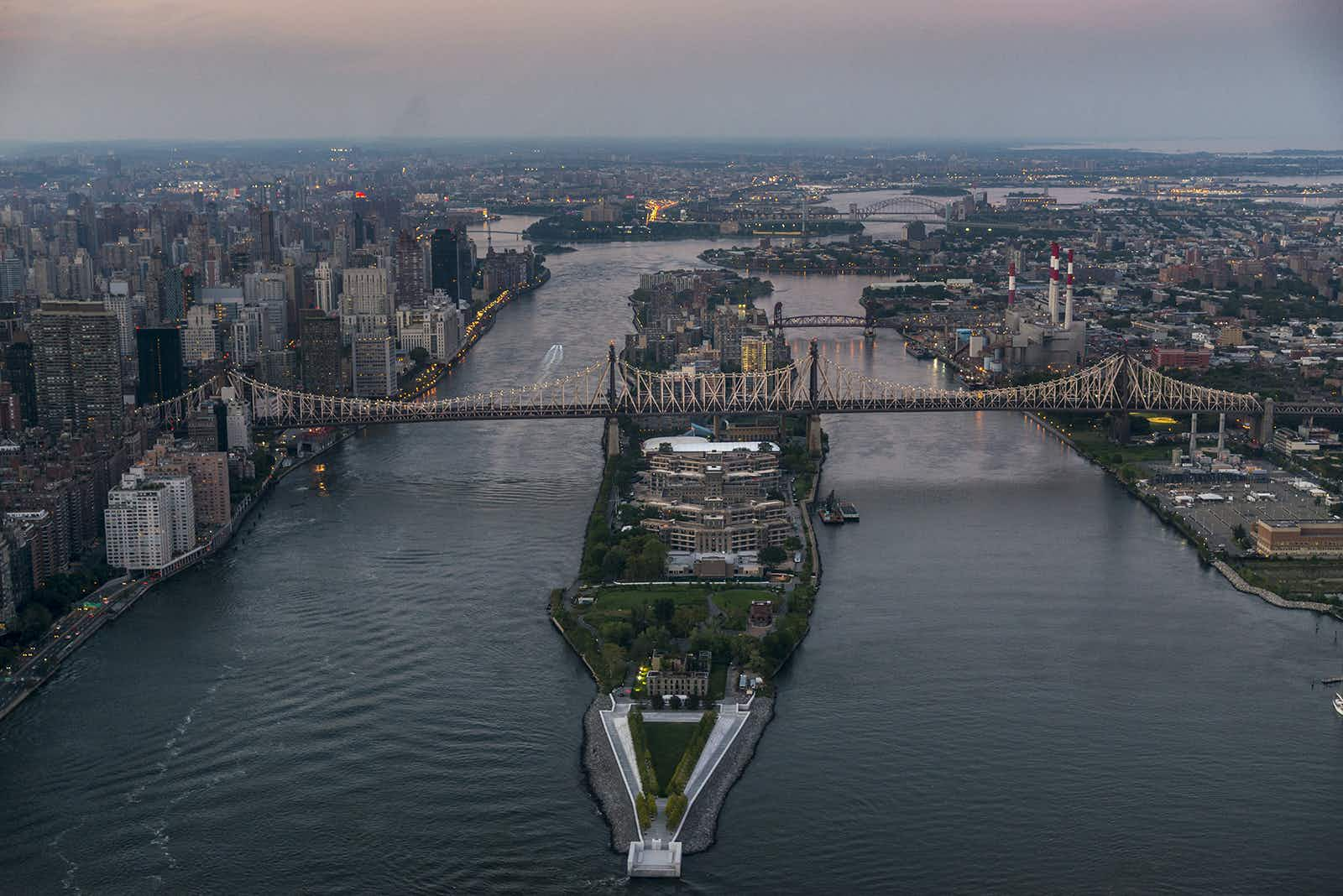 an aerial view of Roosevelt Island at sunset