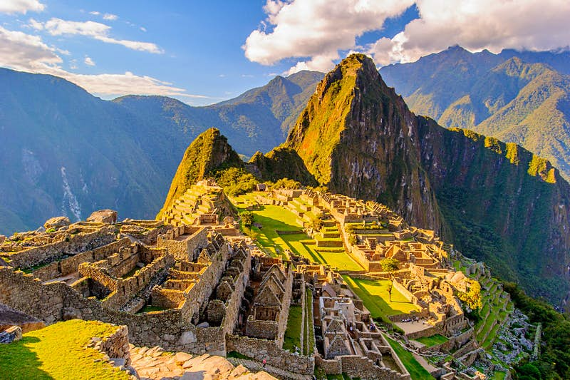 An aerial view of Machu Picchu: an ancient stone settlement stood on a mountaintop.