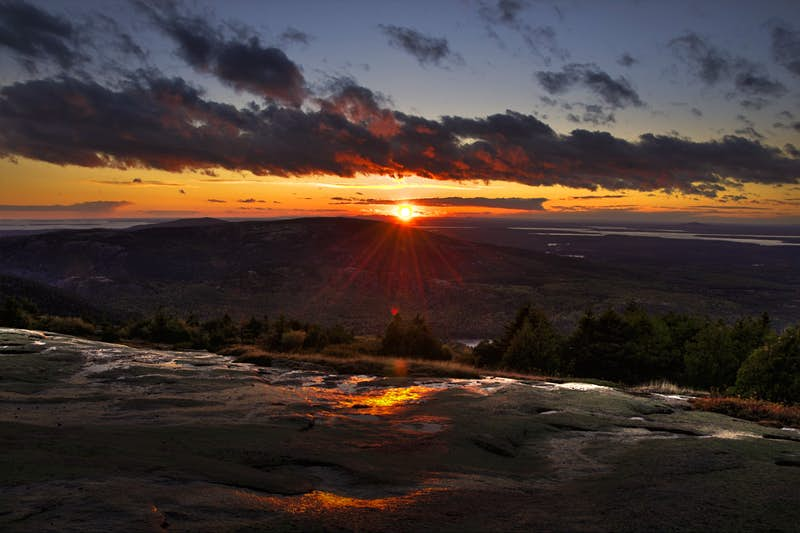 Early morning sun rays as viewed from the top of Cadillac Mountain, Acadia National Park, Maine.