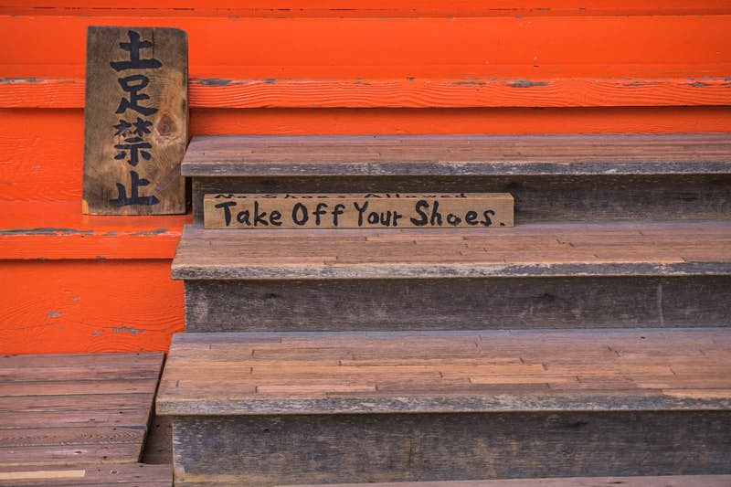 Sign telling people to remove their shoes