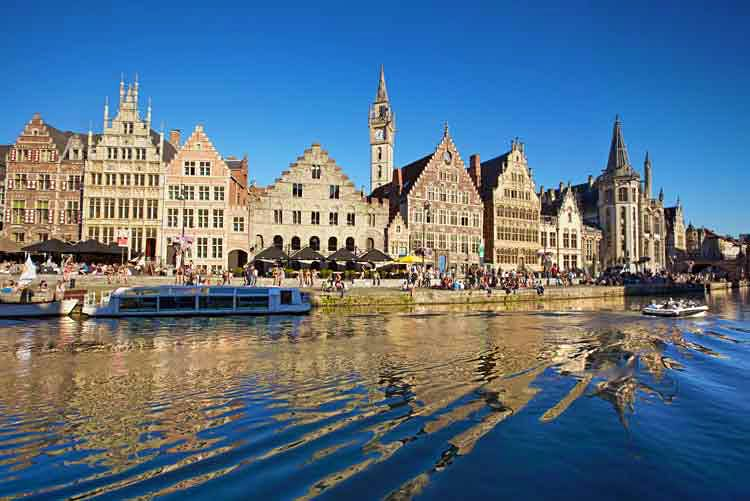 Historic buildings along the River Leie in Ghent, Belgium. Image by Allan Baxter / The Image Bank / Getty Images.