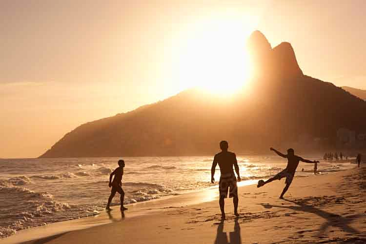 A game of beach football in Rio. Image by Yasuhide Fumoto / The Image Bank / Getty Images.