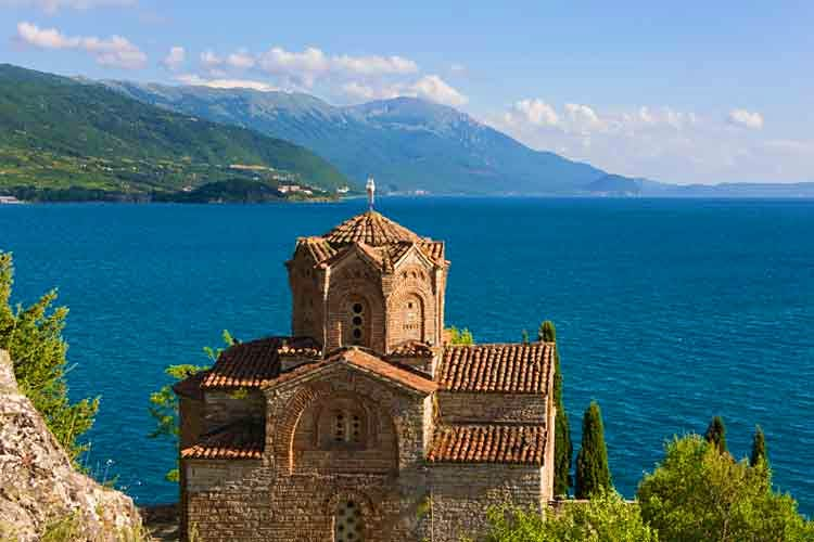 Church on the shores of Lake Ohrid, Macedonia. Image by Keren Su / Photodisc / Getty Images.