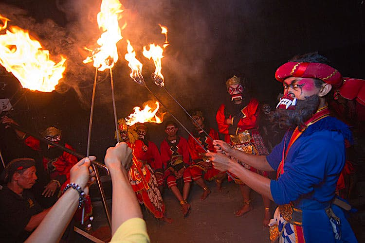 Members of the 'monkey army' holding burning torches. Image by Stuart Butler / Lonely Planet.
