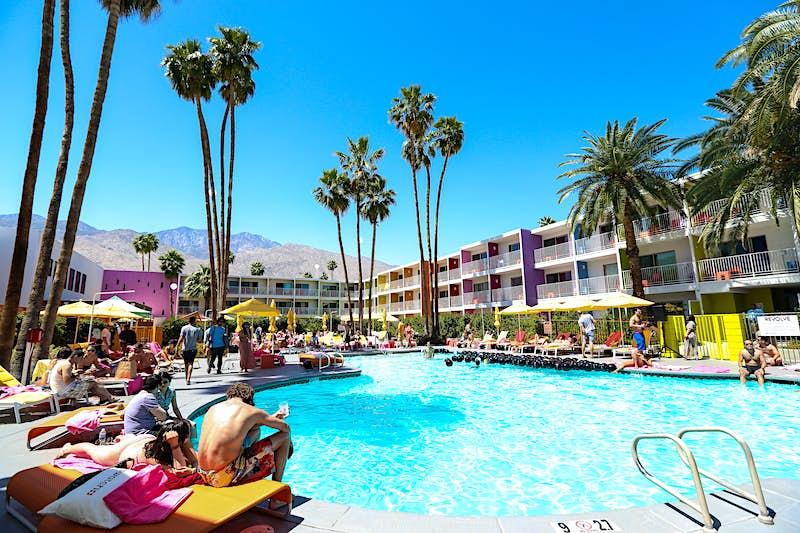 Travellers lounge poolside in Palm Springs