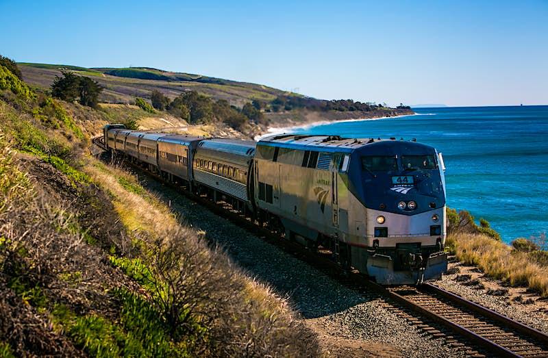 An Amtrak Surfrider train runs along the coast near El Capitan State Beach