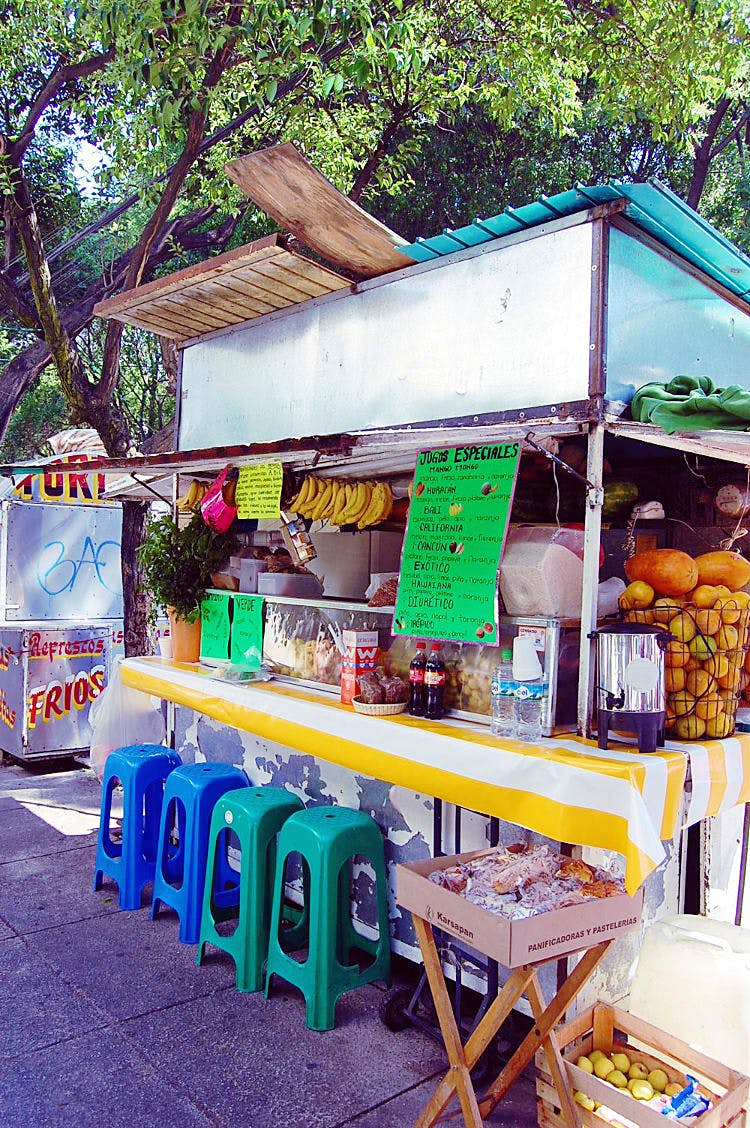 Many different fruit juices are available at roadside stall. Image by Katja Gaskell / Lonely Planet