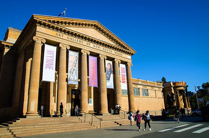 People walk in front of the classical columns at the entrace of the Art Gallery of New South Wales, Sydney, Australia.