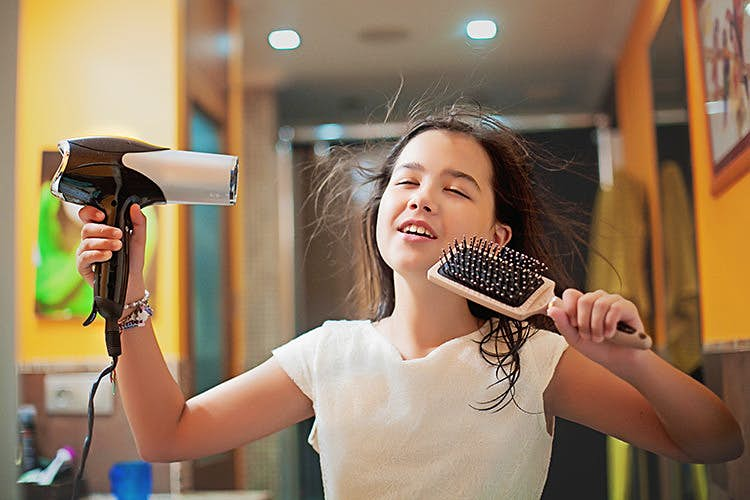 Be tousled on your travels and leave the hairdryer at home. Image by Carol Yepes / Moment / Getty Images