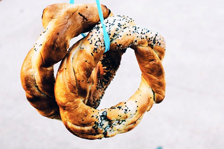 Covrigi are sometimes sold in bunches on the street. Image by Mark Baker / Lonely Planet
