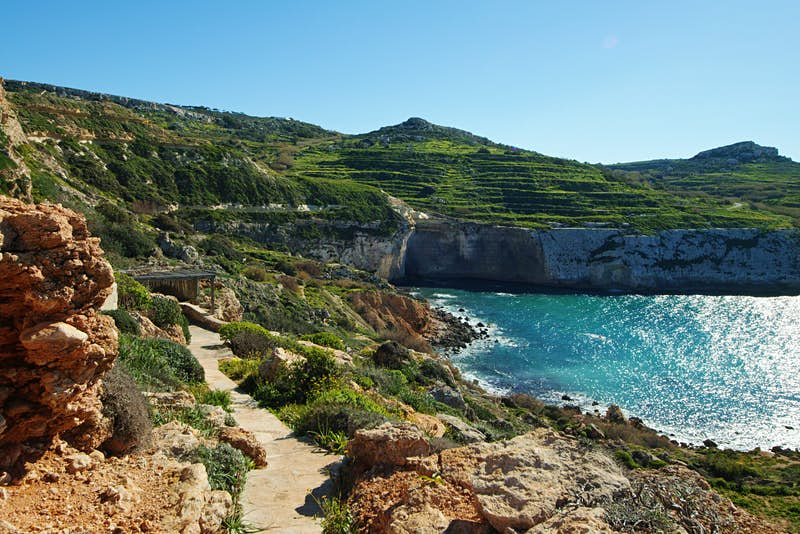 The walkway to Fomm ir-Riħ beach, which winds its way down the cliff to the sea
