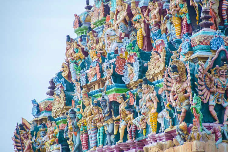 Sculpted deities in rainbow colours on the Meenakshi Amman Temple. Image by cotaro70s / CC BY-ND 2.0.