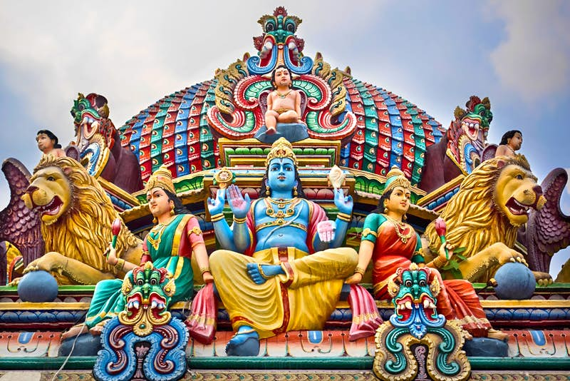 A close-up of colourful statues adorning Singapore's oldest Hindu temple, Sri Mariamman Temple © R.M. Nunes / Shutterstock